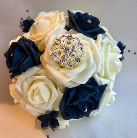 Navy and ivory with navy accents and brooches.