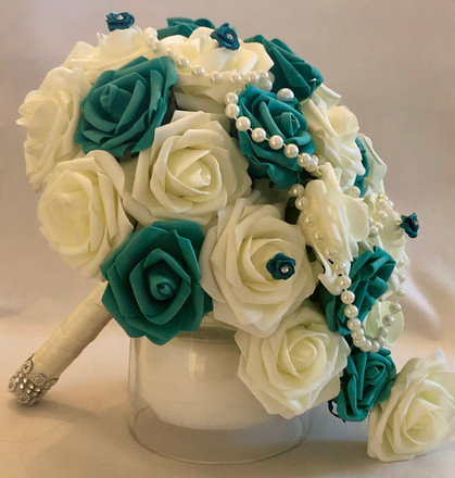 Ivory and teal roses with beads.