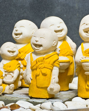 Statue of smiling novice.jpg