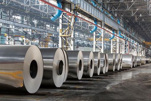 Row of rolls of aluminum lie in producti