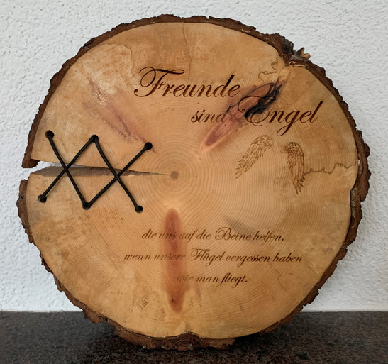 Holzscheibe graviert