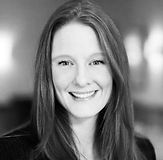 Black and White portrait of Katy Pinter of Greenfields Academy smiling with long straight hair