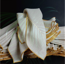 Cotton linen blend dinner napkins with gold embroidery  with a tropical vibe