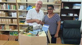 Alex donates books to University Library of Anton de Kom University Suriname