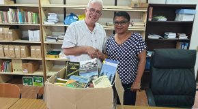 Alex donates books to University Library of Anton de Kom University Suriname