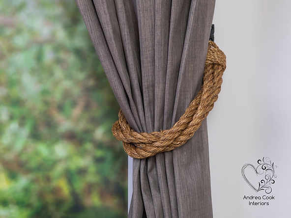 Rustic twisted manila rope curtain tiebacks made with three lengths of rope.