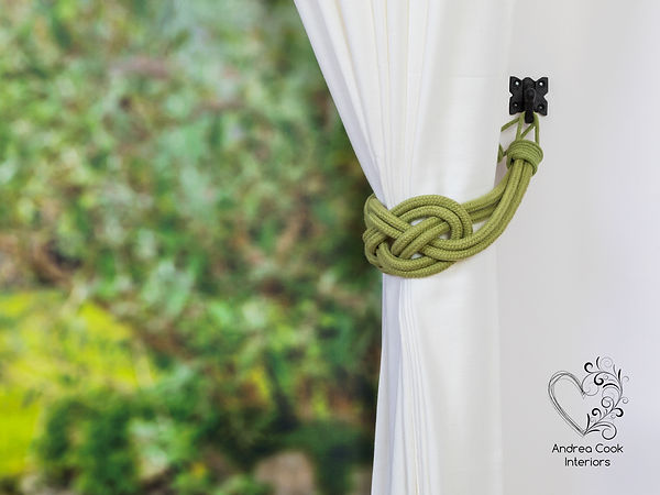 Olive green double carrick knot curtain tieback on a white curtain