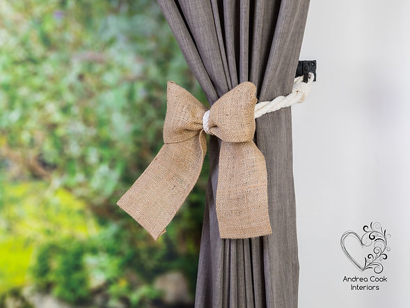 white twisted curtain tieback with a burlap hemp bow