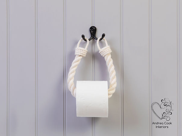 White chunky nautical style rope toilet paper holder with a black double hook