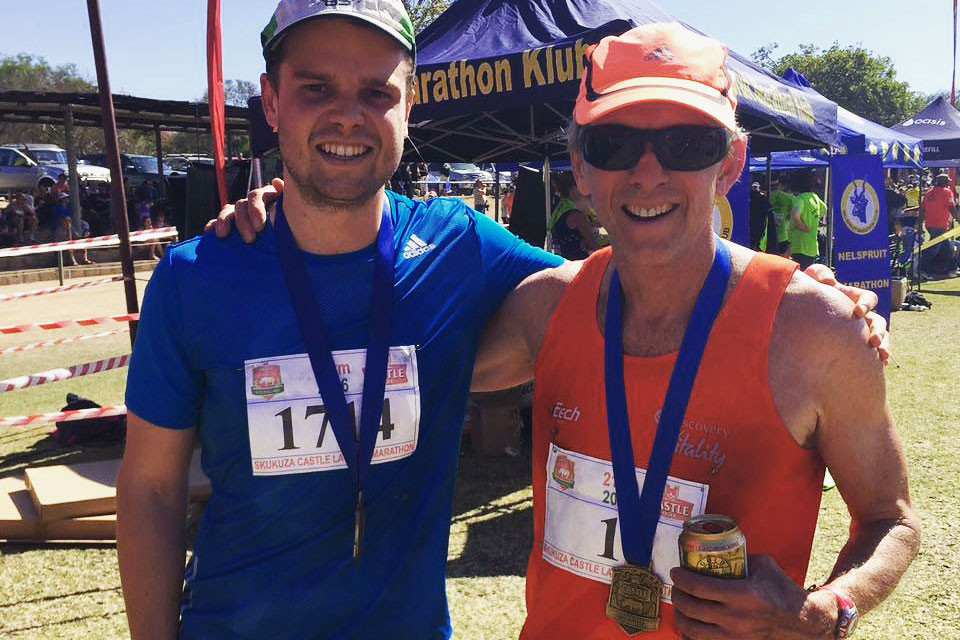 Bruce Fordyce with his son, Jonathan, after Skukuza Marathon, Kruger National Park.