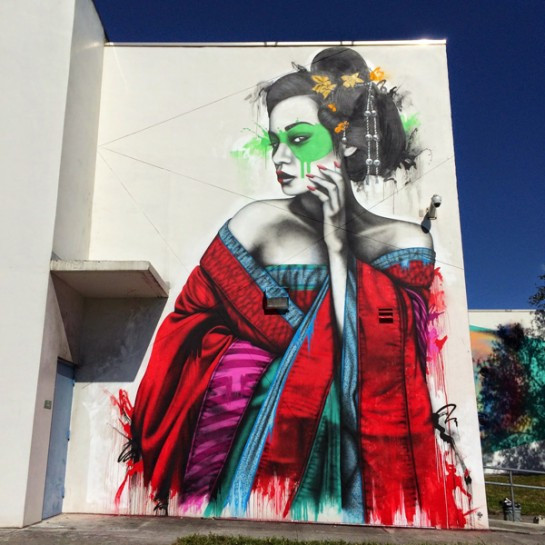 The Irish street artist Fin DAC depicts his signature Asian ladies.
