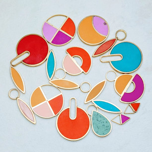 A collection of earrings and necklaces made in custom color combos