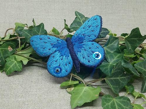 Papillon bleu bijou de cheveux