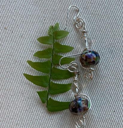 Purple/green mosaic glass bead w/quartz.