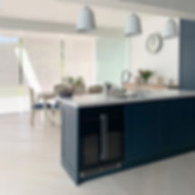 Kitchen - ethical source, seared glass, leather handles, pantry, blues and wood, interior decorating