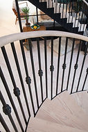 pale wood. iron bannisters