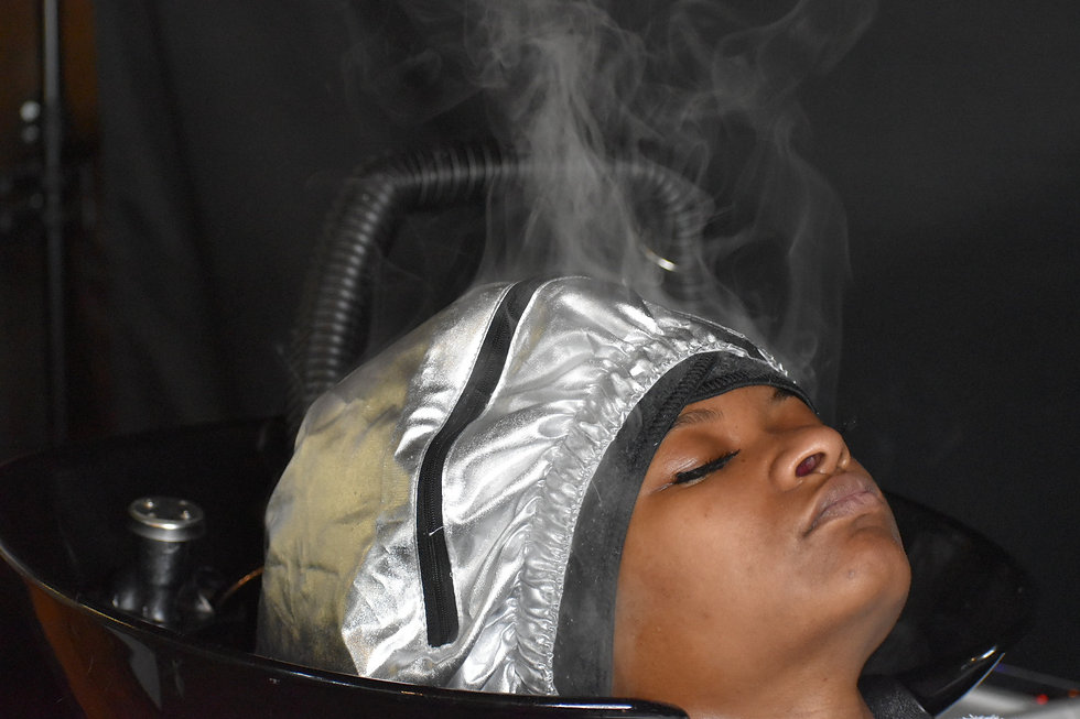 Relaxing during her head spa steam