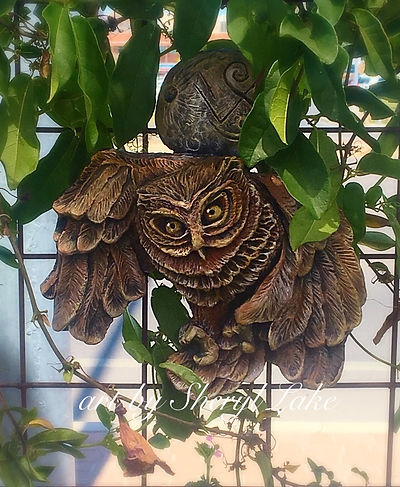 owl with moon sculpture