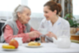 senior woman and nurse insurance benefits