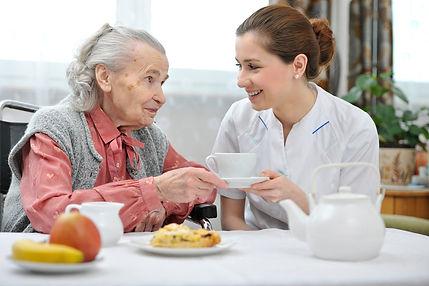 senior woman and nurse insurance benefits