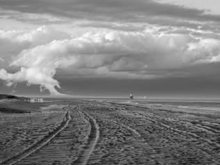 Harbor of Refuge Lighthouse under clouds