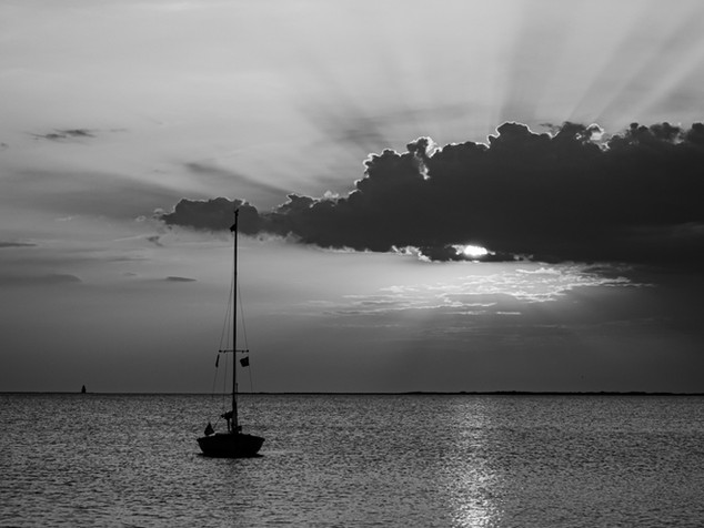 sailboat and sunrays
