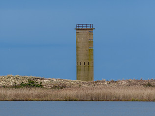 WWII tower and blue sky and water