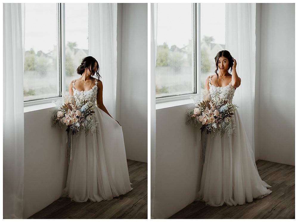 bride in flowy flower dress with modern pastel bouquet