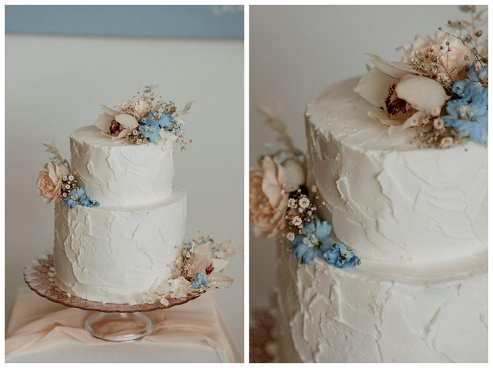 white, pastel pink and blue textured wedding cake