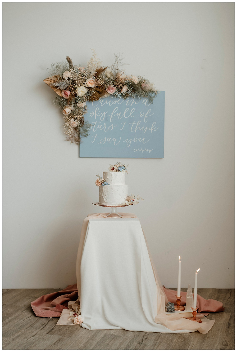 pastel pink and blue cake table and coldplay quote