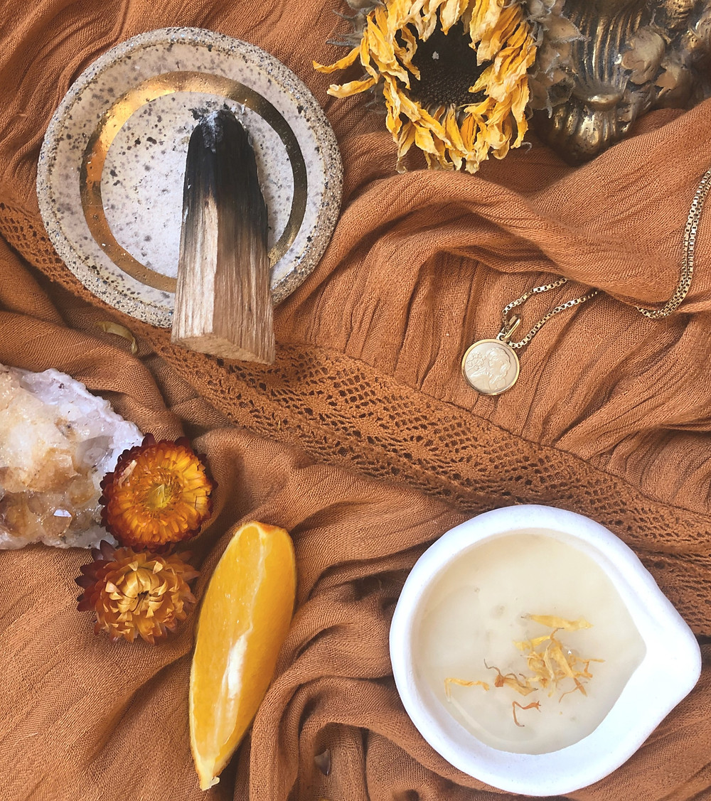 Full moon offerings including gold, honey with calendula, citrus, flowers, and palo santo
