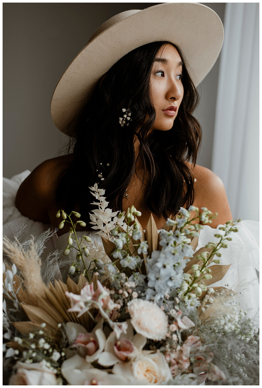 bride with baby's breath in hair