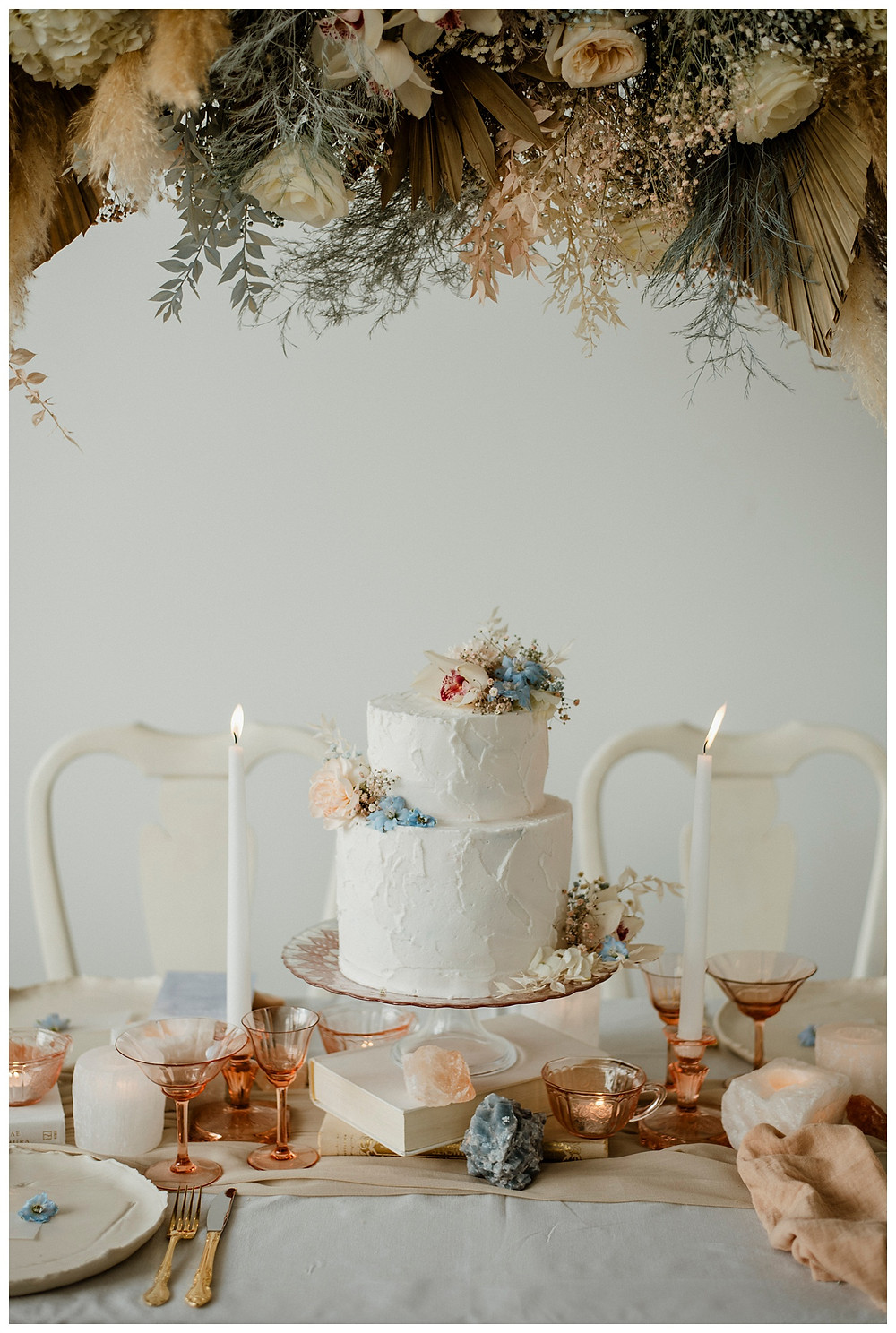 pastel cake tablescape with crystals and pink depression glass