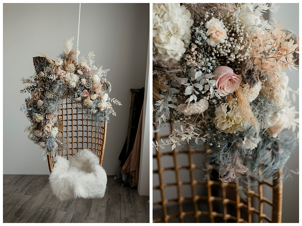 dried and fresh floral installation on rattan chair
