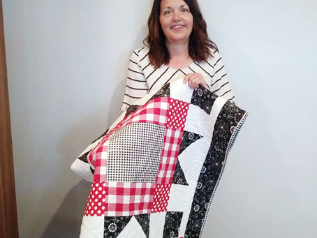 "COMMUNITY - ""Quilt fundraiser brings warm support to the community"""