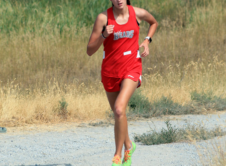 "SPORTS – ""Madison White runs to a first-place finish at the Cache Box Invite"""
