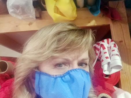 """FEATURE - """"Many hands can move mountains: Sewing hope into medical masks"""""""