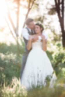 bride and groom embrace as the sunsets in amador county california