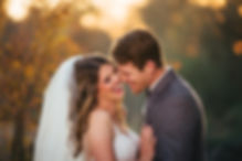 bride and groom laugh in the sunst of Amador county california