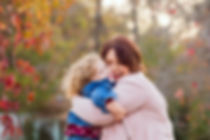 mom and daughter laugh and hug