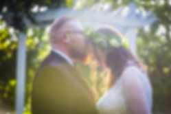 groom kisses bride hartford gardens sutter creek