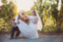 bride and grom on couch in corn field yolo county california