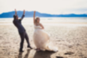 bride and groom cheer on tahoe nevada beach