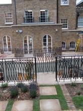 Cast iron railing panels forming balustrade
