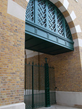 Intricate bespoke cast iron gate posts with fabricated steel gate and cast finials.