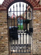 Highly intricate – completely bespoke cast iron gate – this gate comprises of a fabricated steel frame and several cast components which were then cut and welded.