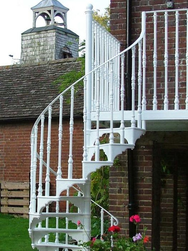 Cast iron spiral staircase finished in white. Popular for both internal and external use.