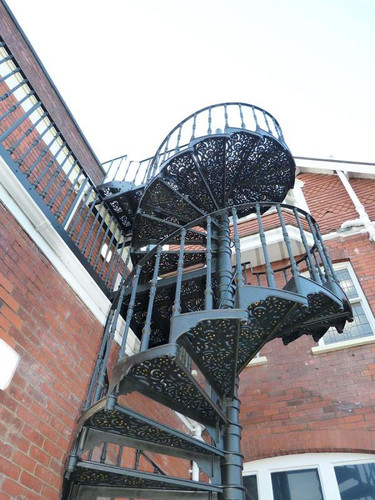 One of the larger cast iron spiral staircases we have installed. Extending over three stories this fully cast spiral staircase takes its inspiration from the once commonplace Victorian spiral fire escape.