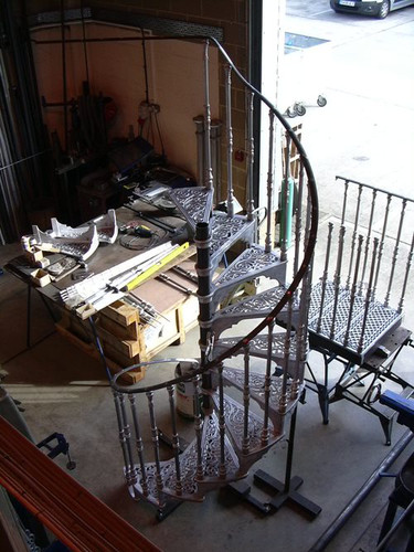An aluminium spiral staircase in our workshop pre-install. Our ability to cast in both iron and aluminium has many advantages. For staircases such as this the most obvious is the weight. Taking the traditional patterns and crafts and adding a modern touch.