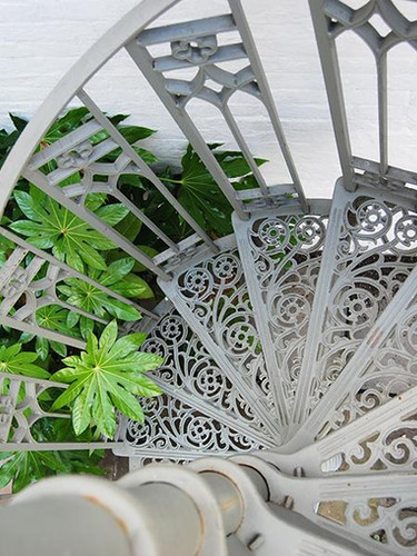A closer look at one of our cast iron spiral staircases – this picture shows in detail one of the most popular tread patterns we provide the rose pattern.